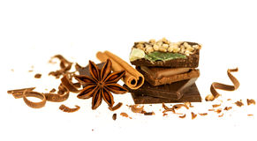 Dark and milk chocolate bars with cinnamon stick and anise star. Isolated on white background Royalty Free Stock Images