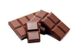 Dark milk chocolate bars stack isolated on a white Royalty Free Stock Images