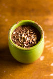 Dark and milk chocolate mousse or cream with chopped hazelnuts and rum in a jar Stock Photography