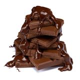 Dark or milk chocolate pieces stack and chocolate syrup isolated on white. Background royalty free stock images