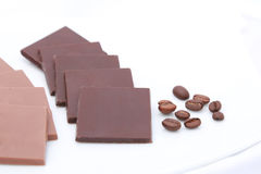 Dark and milk chocolates with coffee beans. Dark and milk chocolate bars Royalty Free Stock Photo