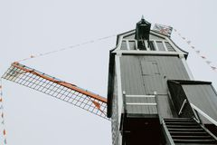 Dark mill a cloudy day in bruges belgium royalty free stock photography