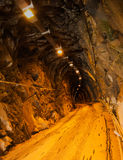 Dark mine tunnel with lights, vertical - marble qu Stock Photo
