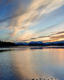 Dark Mirror. Pre Dawn sky is reflected off calm bay waters Royalty Free Stock Photo