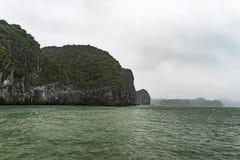 A dark and misty overcast morning on Halong Bay Vietnam. A dark and misty overcast morning on Halong Bay, Vietnam stock photo