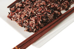 Dark mixed rice on plate Royalty Free Stock Image