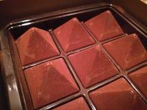 Dark mocha pyramid chocolate in a box for festive season. In Valentine`s day Stock Image