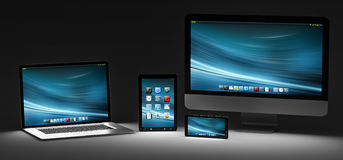 Dark modern computer laptop mobile phone and tablet 3D rendering. Modern computer laptop mobile phone and tablet in the dark 3D rendering Royalty Free Stock Images