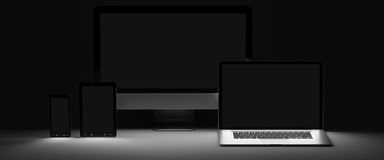 Dark modern computer laptop mobile phone and tablet 3D rendering. Modern computer laptop mobile phone and tablet in the dark 3D rendering Stock Photos