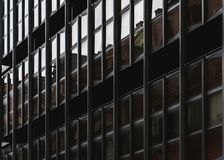 Dark modern facade of dwelling house stock images