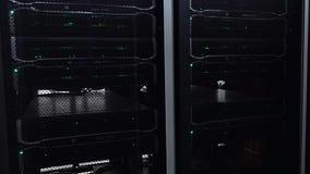 Dark modern working data servers with flashing LED green lights. stock footage