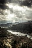 Dark moody mountains landscape in autumn season  around canyon with Rijeka Crnojevica river curve from high view in overcast day w. Dramatic mountains landscape Stock Photo