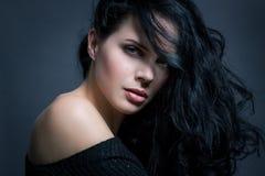 Dark moody portrait of a brunette beauty Stock Photography