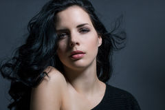Dark moody portrait of a brunette beauty Royalty Free Stock Photos