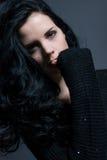 Dark moody portrait of a brunette beauty Stock Images