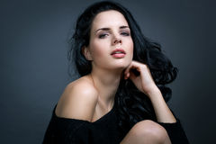 Dark moody portrait of a brunette beauty Royalty Free Stock Photography