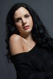 Dark moody portrait of a brunette beauty Stock Image