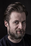 Dark moody portrait face of caucasian bearded man Stock Photography
