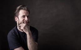 Dark moody portrait of happy caucasian man Stock Images