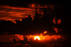 Dark moody red sunset sky Stock Image