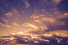 Dark moody stormy sky with clouds, abstract background. Dark moody stormy sky with clouds, abstract nature background with purple orange toned photo filter Stock Images