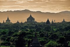 Dark moody sunset with ancient temples in Bagan, Myanmar Stock Photo