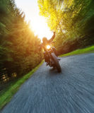 Dark motorbiker riding high power motorbike Royalty Free Stock Photos