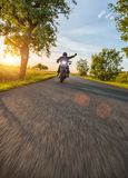 Dark motorbiker riding high power motorbike in sunset Royalty Free Stock Photo