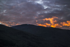 Dark Mountains in the Evening. Dark mountains lit by setting sun Royalty Free Stock Image