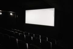 Dark movie theatre interior. Royalty Free Stock Photography