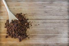 Dark muscovado sugar in a wooden spoon Royalty Free Stock Photos