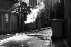 Dark mysterious alleyway. On a rainy day Royalty Free Stock Photography