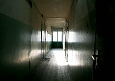 Dark mysterious corridor in building. Door room perspective in lonely quiet building with dramatic light. Horror landscape concept royalty free stock image