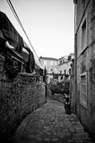 Dark narrow street in old town Stock Images