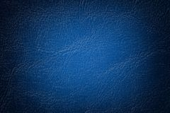 Dark navy blue leather texture background, closeup. Denim cracked backdrop from wrinkle skin stock photos
