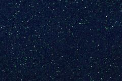 Dark navy blue sparkling background from small sequins, closeup. Brilliant shiny backdrop from textile. Shimmer paper.  stock images