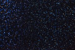 Dark navy blue sparkling background from small sequins, closeup. Brilliant shiny backdrop from textile. Shimmer paper.  stock photos