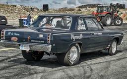 Dark navy racing car view from behind. Royalty Free Stock Image