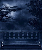 Dark Night. Fantasy background with dark night, trees, balconies and candles Stock Photos