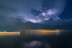 Dark night with lightning above stormy on sea Stock Photography