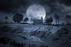 Dark Night. Photo composition with an abandoned haunted house for Halloween holiday Royalty Free Stock Photography