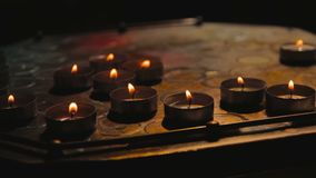 Dark oil candles at night stock video footage