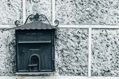 Dark old Mailbox on an  gray stone wall. Place for text Royalty Free Stock Images