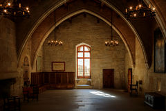Dark old room in Poblet cloister. With stained glass window and candelabra, Spain Stock Photos