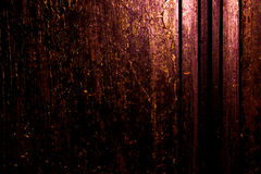 Dark old scary rusty rough golden and copper metal surface texture/background for Halloween or haunted house games background/text Royalty Free Stock Photography