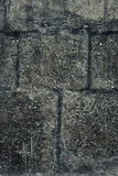 Dark old stone wall for texture or background, grunge style Royalty Free Stock Images