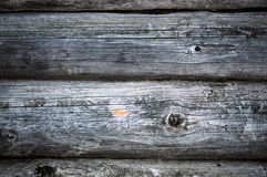 Dark old timbered wooden loghouse wall. Dark country timbered wooden loghouse wall with fracture Royalty Free Stock Images