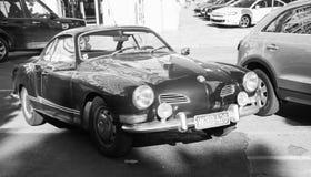 Dark old-timer Volkswagen Karmann Ghia stands Stock Image
