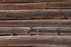 Dark old wooden boards with light spots, are horizontally arranged Stock Photo