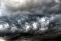 Dark ominous grey storm clouds. royalty free stock images